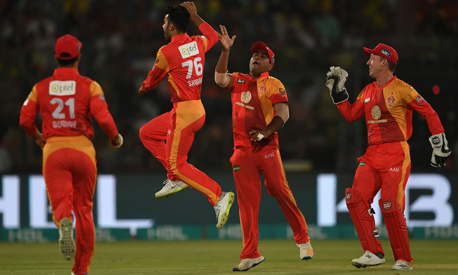 Shadab Khan celebrates with teammates after taking the wicket of Darren Sammy. —AFP