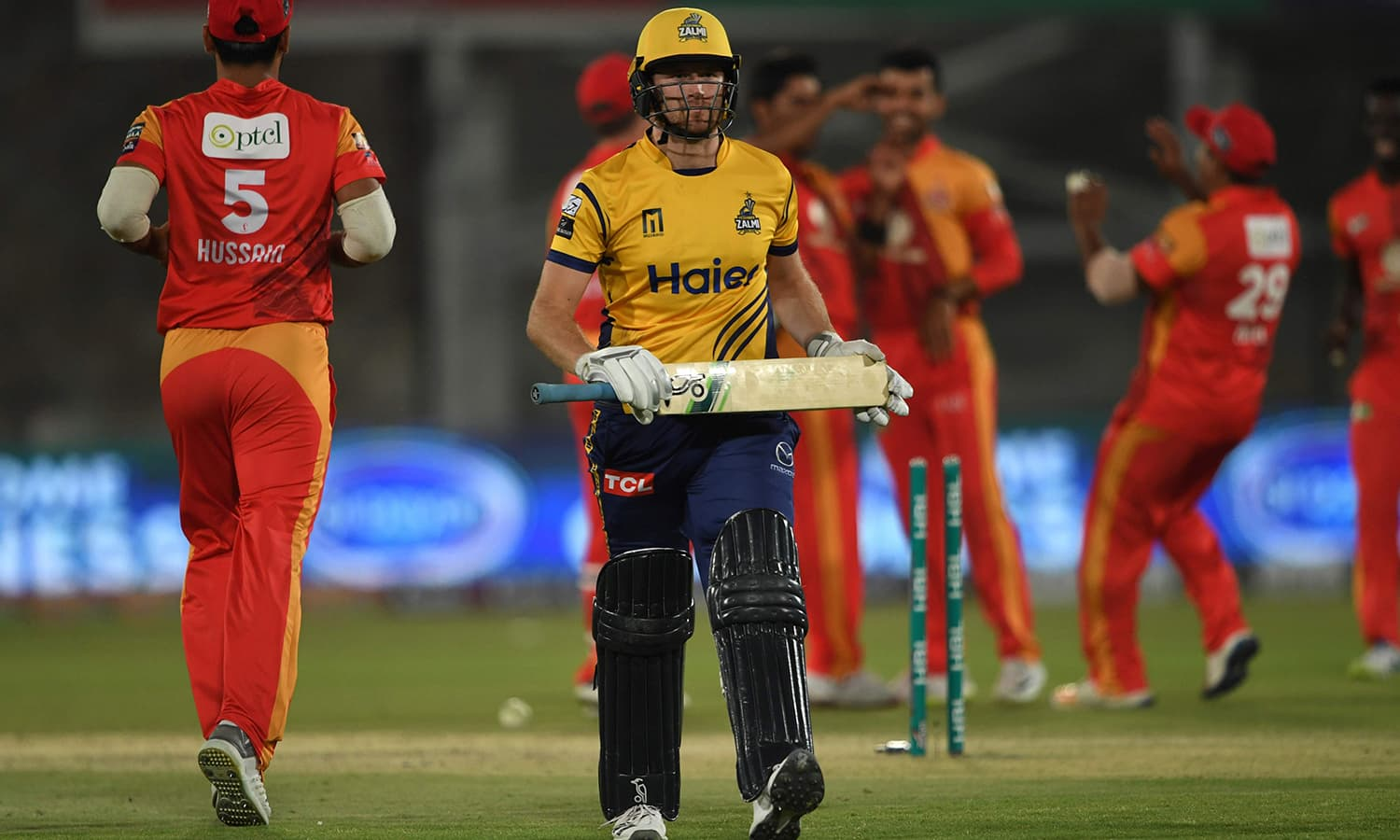 Liam Dawson of Zalmi walks back after clean bowled by Mohammad Sami of United. —AFP