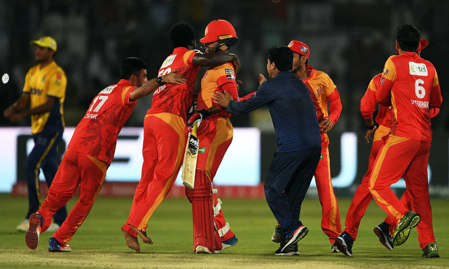 Islamabad United players celebrate their victory. —AFP
