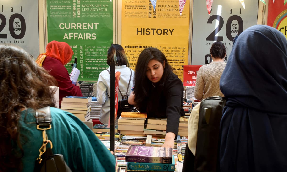 Attendees at the ninth annual Karachi Literature Festival browse through books | Tahir Jamal, White Star