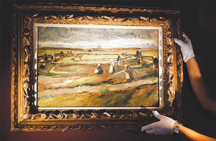 PARIS: Van Gogh's painting 'Women mending nets in the dunes' is being presented for auction.—AFP