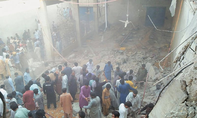 Rescue work under way after the roof of a warehouse collapsed in a dates market of Rohri on Wednesday.—PPI