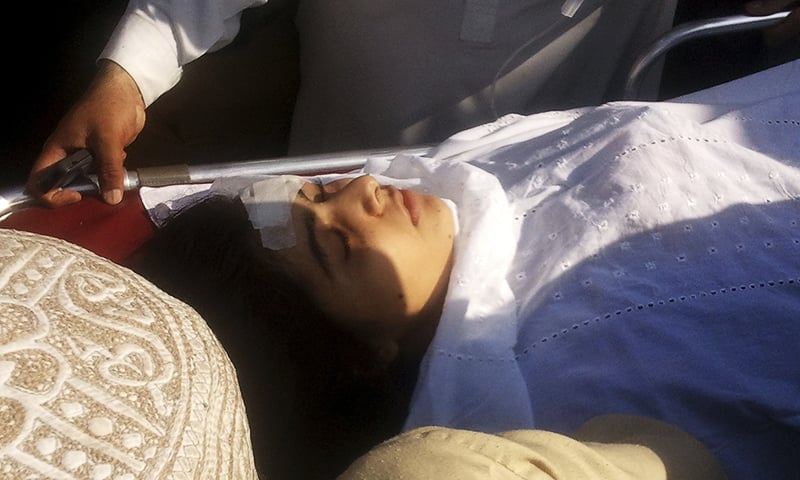 In this Oct 9, 2012, file photo, a wounded Malala Yousufzai iss moved to a helicopter to be taken to Peshawar for treatment in Mingora, Swat. ─ AP