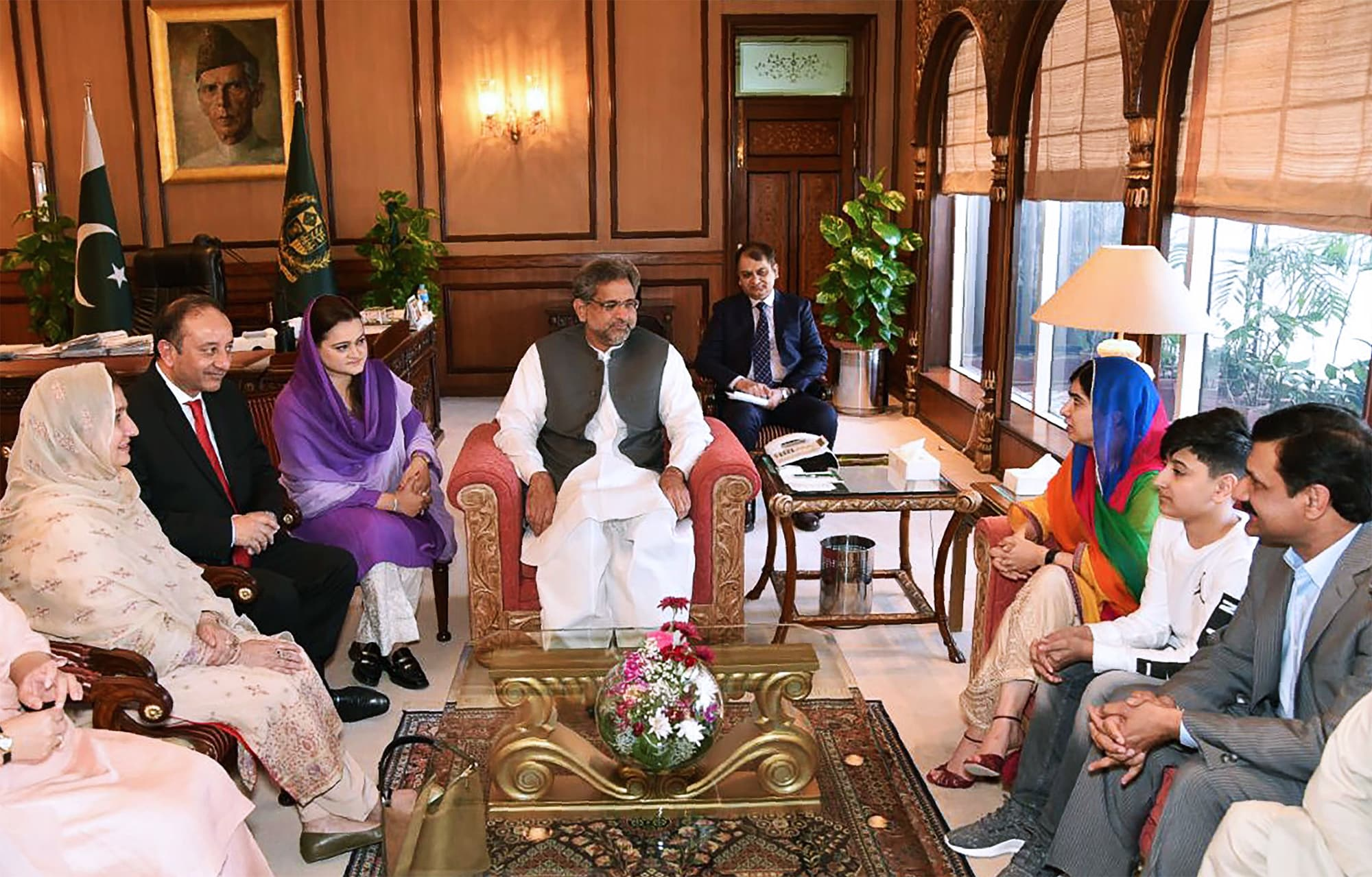 This handout photograph released by the Press Information Department (PID) on March 29, 2018, shows Prime Minister Shahid Khaqan Abbasi (C) meeting with Malala Yousafza (3R) and her family at Prime Minister Office during her visit to Islamabad. ─ AFP