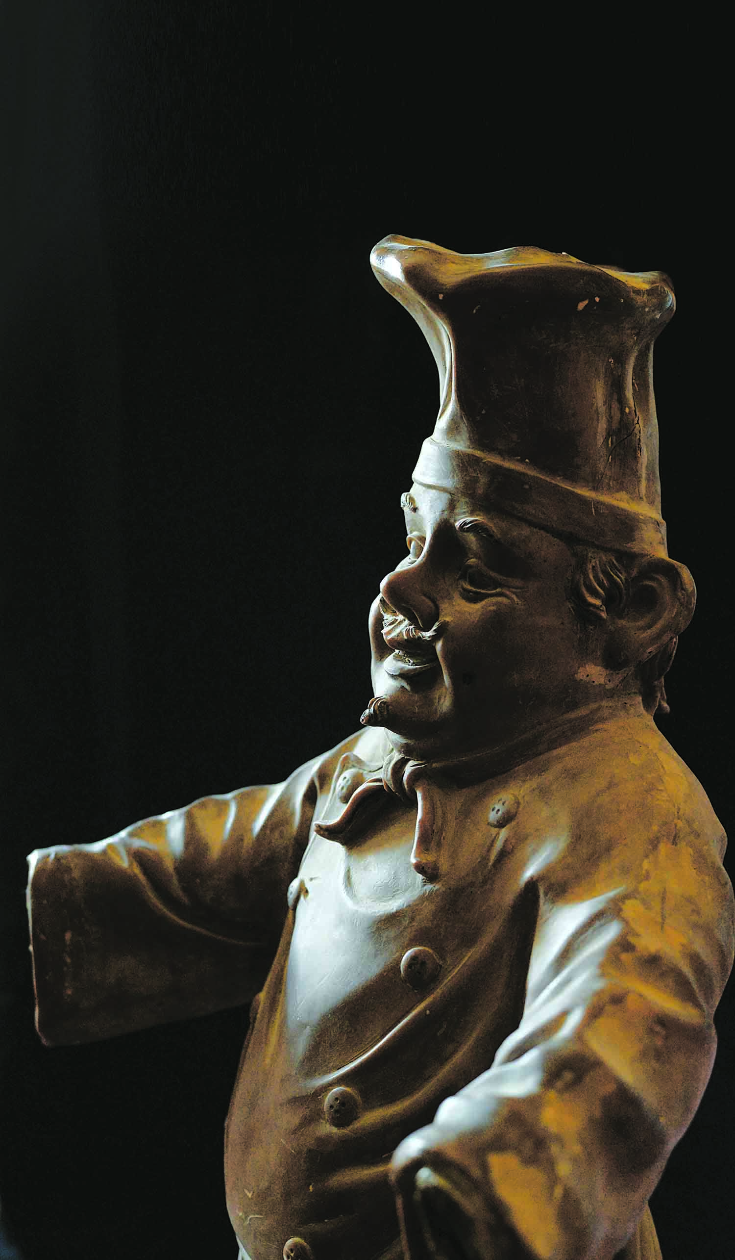 This effigy of a rotund chef once greeted the patrons of Mexicano, a continental restaurant located where Zainab Market is situated today. Mexicano was very popular in the sixties and the 'chef' was accompanied by a 'butler' who welcomed visitors as he held a domed-dish upon a tray, with a certain panache. He rather resembled Cadbury, Richie Rich's butler. Mexicano closed down after several years. Like Mexicano, many of the restaurants people remember fondly from that era no longer exist. (Photo: Arif Mahmood/ Dawn White Star)