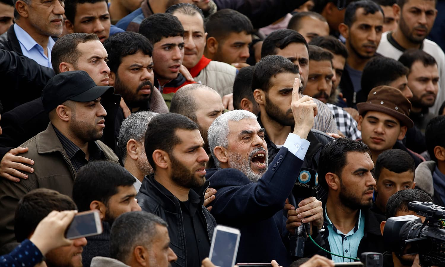 Hamas movement leader Yahya Sinwar shouts slogans as he takes part in a tent city protest near the border with Israel. ─AFP