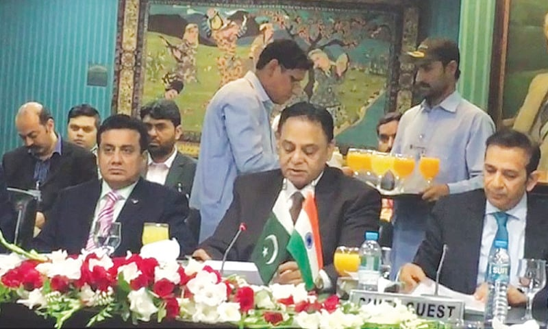 INDIAN High Commissioner Ajay Bisaria addresses the audience at the Lahore Chamber of Commerce and Industry.—DawnNews
