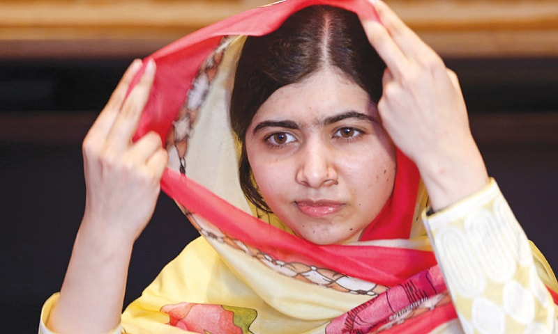 NOBEL laureate Malala Yousafzai adjusts her dupatta as she speaks during an interview on Friday.—Reuters
