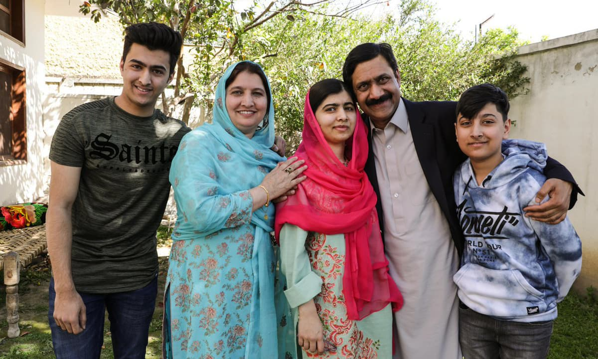 Malala Yousafzai poses for photograph with her family members at her native home during a visit to Mingora on Saturday. ─ Photo courtesy Malala's Twitter