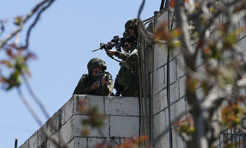 Israel says it will expand response if Gaza clashes go on