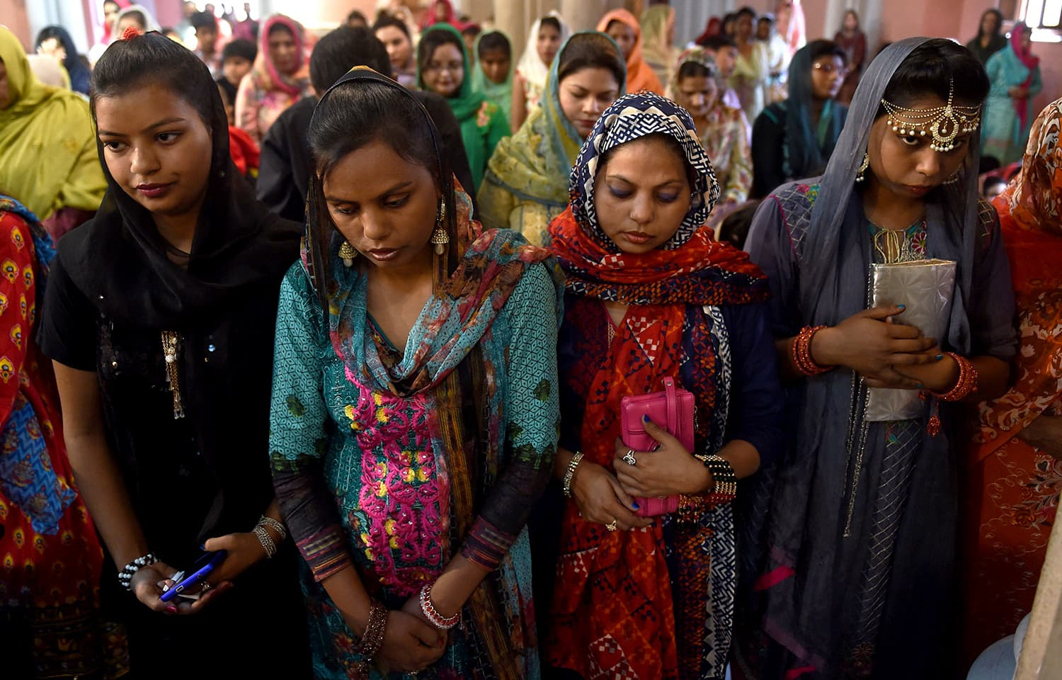 Christians attend Easter mass at the Sacred Heart Cathedral Church in Lahore. —AFP