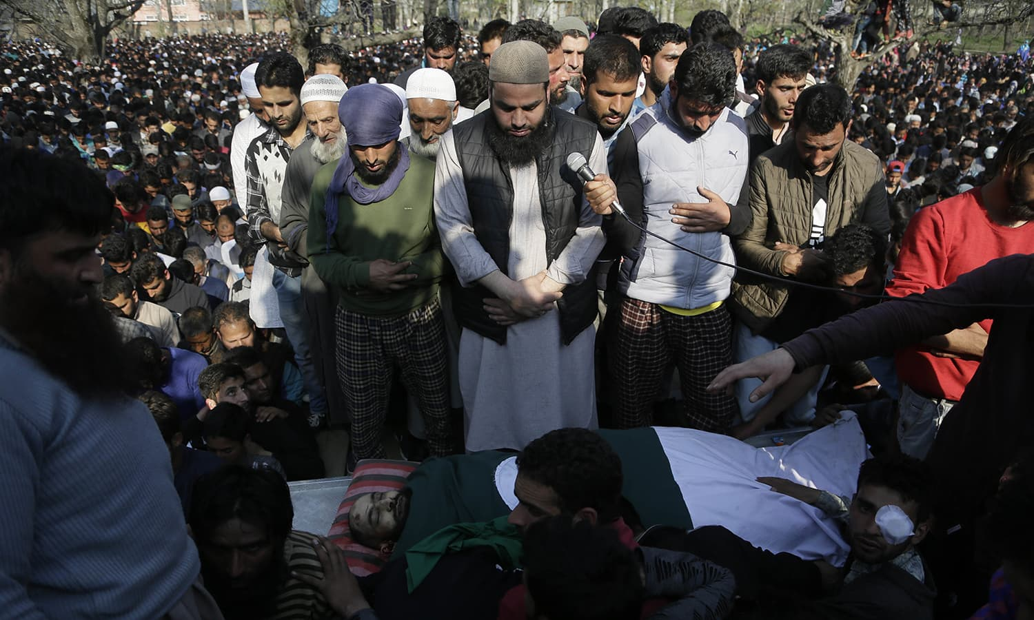 Villagers offer funeral prayers near the body of Zubar Ahmad, one of the killed rebels at Shopian. —AP