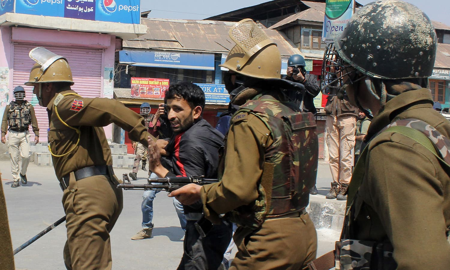 Indian policemen detain a Indian Kashmiri. —AFP