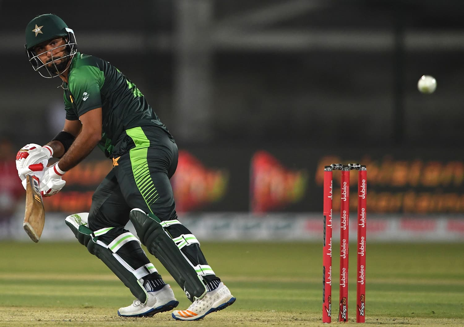 Hussain Talat watches the ball after playing a shot during the first T20 cricket match between Pakistan and West Indies. ─AFP