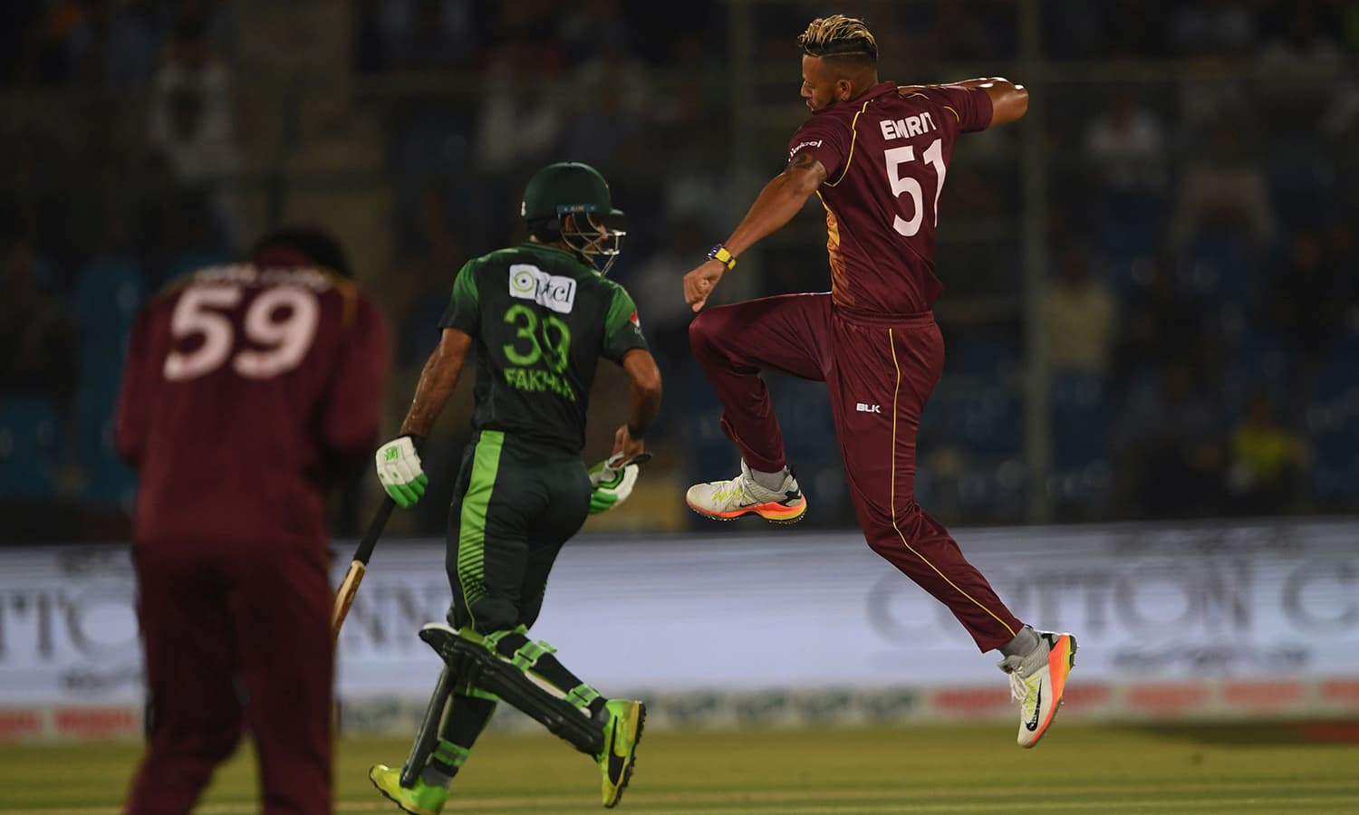 West Indies cricketer Rayad Emrit celebrates after taking the wicket of unseen Pakistani batsman Babar Azam during the first T20 cricket match between Pakistan and West Indies. ─AFP