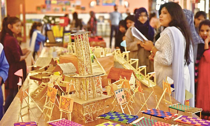 Visitors at the student art exhibition at SMB Fatima Jinnah Government School on Saturday look at the various displays while appreciating the creativity and knowledge of government school students.—Fahim Siddiqi / White Star