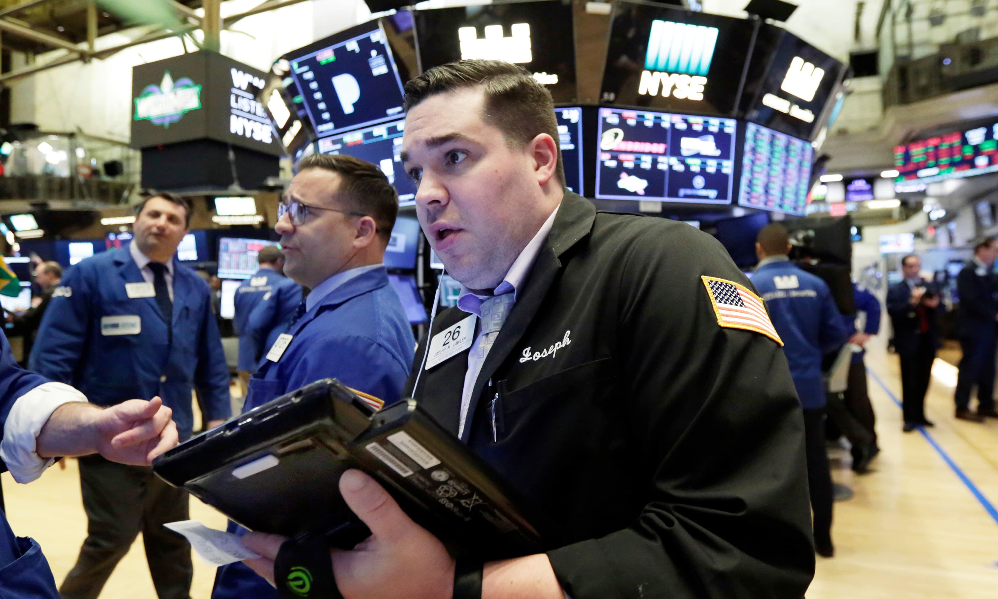 US stocks tumble, Dow dips 750 points as China puts tariffs on US goods