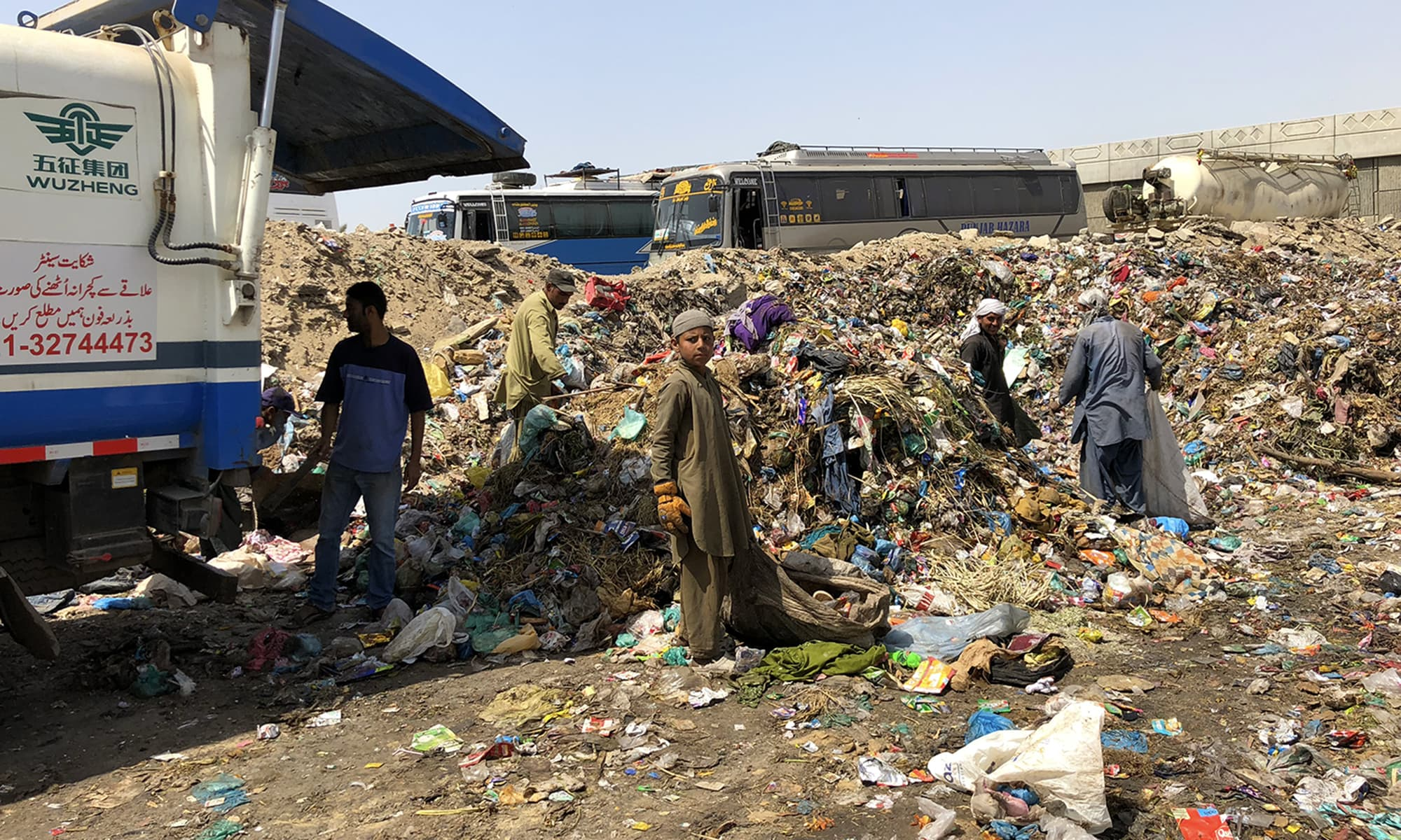 Afghan children sift through the garbage. — Photo by author