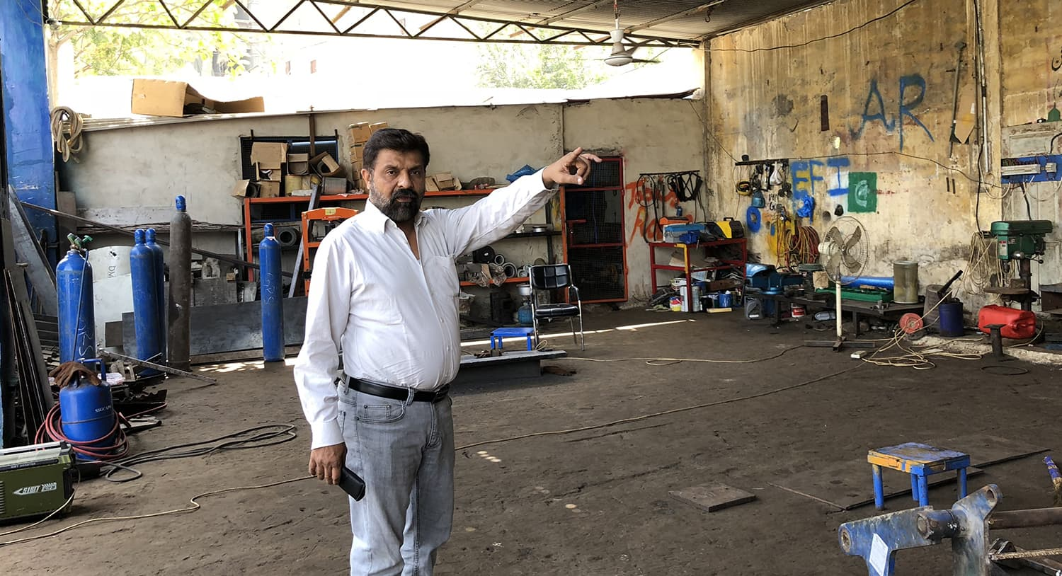 The Chinese company has set up their own workshop where their vehicles are repaired says Maqsood Soomro, assisant director SSWMB responsible for keeping District South clean. — Photo by author