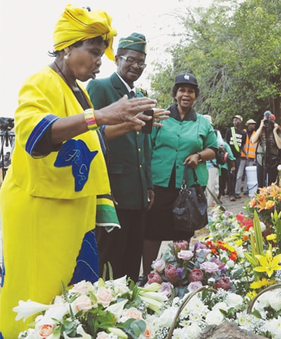 PEOPLE gather outside the family home of the late Winnie Madikizela-Mandela, in Soweto, South Africa, on Wednesday.—AP