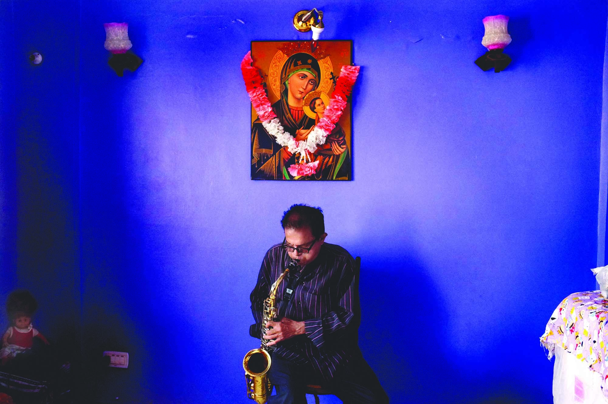 Hillary Furtado playing the saxophone at his home in Karachi. Furtado was part of a generation whose forefathers left Goa in the 18th century to seek greener pastures in Mumbai, Karachi and even further afield. The Goan community which settled in Karachi embraced the city and contributed to its development. Perhaps their biggest contribution was to Karachi's music scene. Naturally drawn to any musical score that brought with it a rhythm or a 'swing', Karachi's Goan community began to form live bands and give public performances. Such was their success, they soon were much in demand to play at clubs, hotels and other night spots. When lifestyles changed significantly in Karachi in the seventies, the era of the Goan bands ended. Furtado, said to be a virtuoso on the saxophone, continued to perform from time to time at private parties until his death two years ago. (photo: Arif Mahmood/ Dawn White Star)