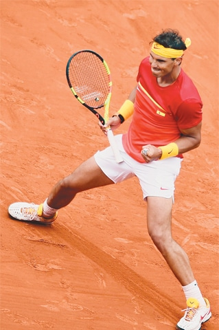Spain's Rafael Nadal celebrates a point during his match against Philip Kohlschreiber of Germany in the Davis Cup quarter-final on Friday.—AFP
