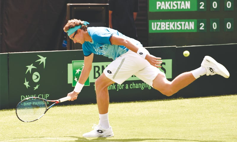 Istomin fails to catch up with Aisam's backhand.—White Star
