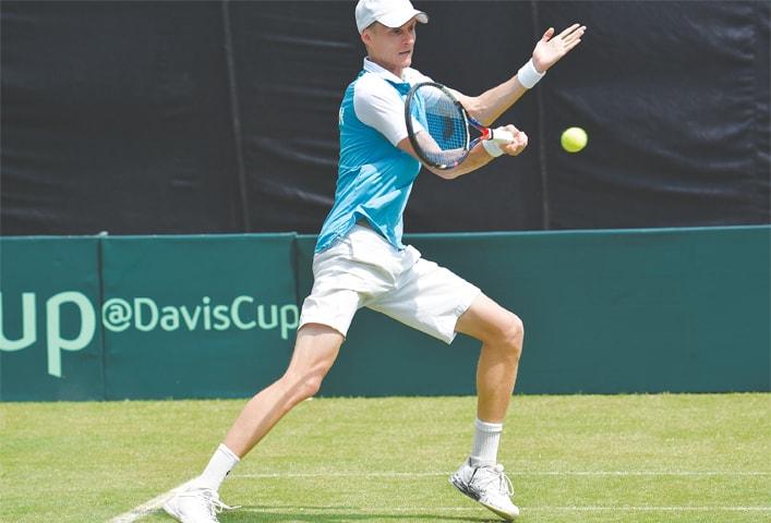 Uzbekistan's Sanjar Fayziev competes.—White Star