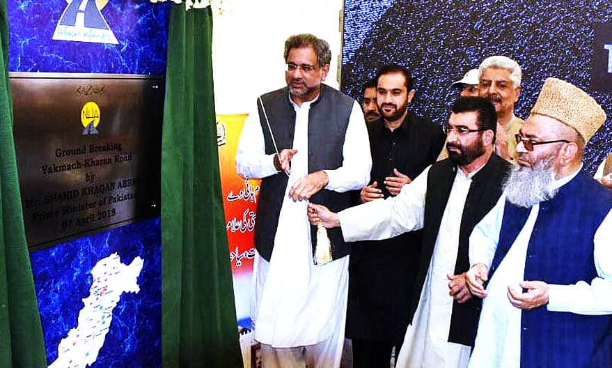 Prime Minister Shahid Khaqan Abbasi unveils the plaque during the groundbreaking ceremony of Yakmach-Kharan Highway. —APP