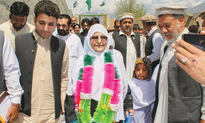 PARACHINAR: Tribal elders welcome Ali Begum at the inauguration ceremony of her election office on Saturday.—Dawn