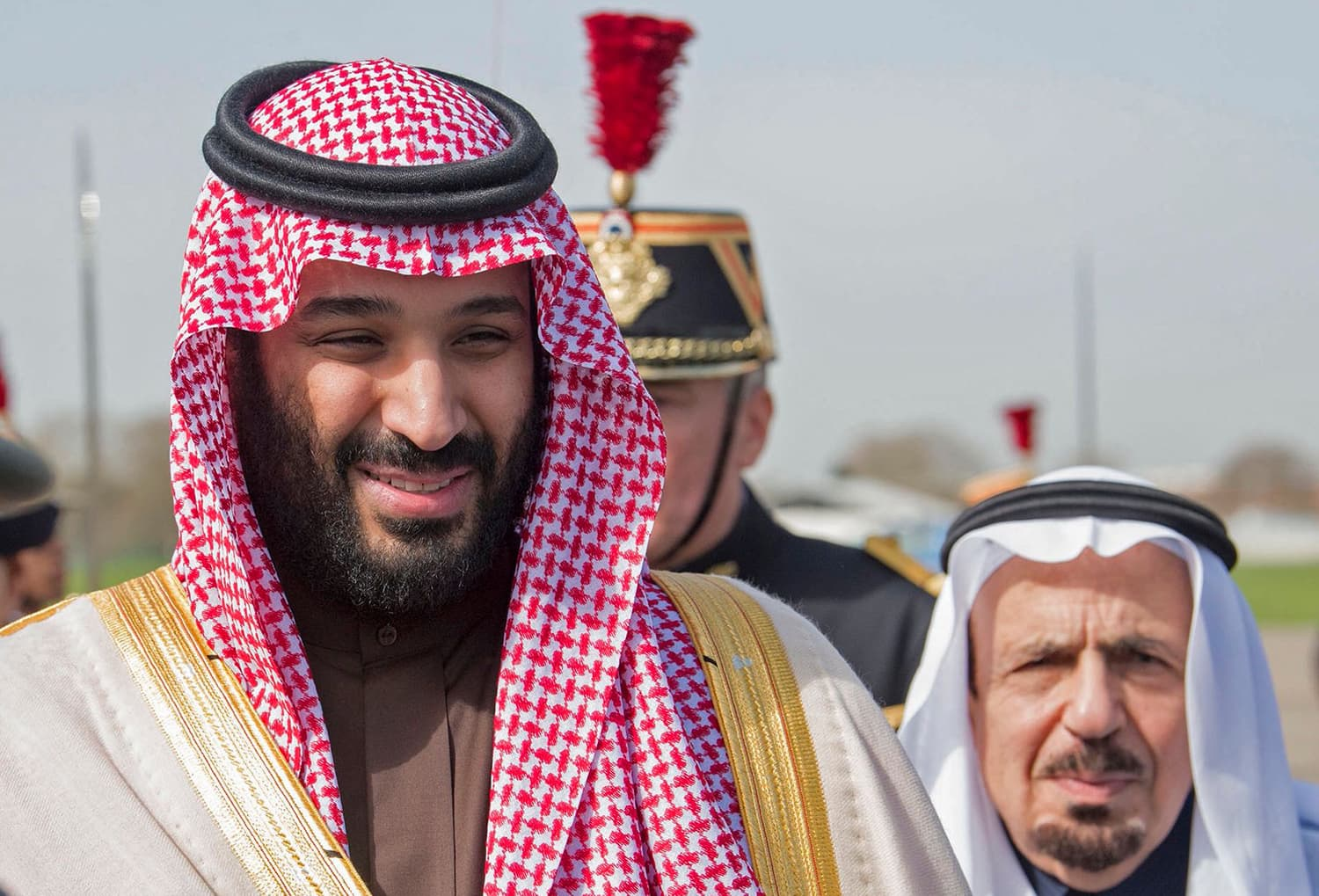Saudi Arabia's crown prince Prince Mohammed bin Salman (L) arrives at Le Bourget airport, north of Paris, on April 8, 2018, ahead of a state visit. — AFP