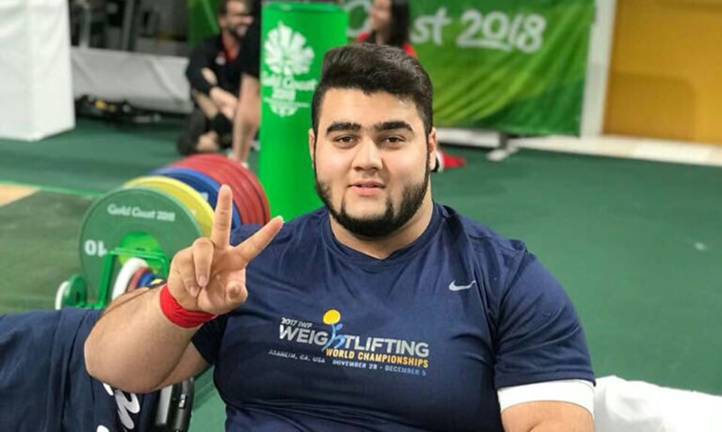 Twenty-year-old weightlifter secures a podium finish after lifting 395kg in +105kg event. —photo provided by author