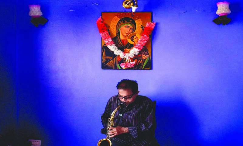 Hillary Furtado playing the saxophone at his home in Karachi. Furtado was part of a generation whose forefathers left Goa in the 18th century to seek greener pastures in Mumbai and Karachi. The Goan community which settled in Karachi embraced the city and perhaps their biggest contribution was to Karachi's music scene. When lifestyles changed significantly in Karachi in the seventies, the era of the Goan bands ended. Furtado, said to be a virtuoso on the saxophone, continued to perform from time to time at private parties until his death two years ago. (photo: Arif Mahmood/ Dawn White Star)