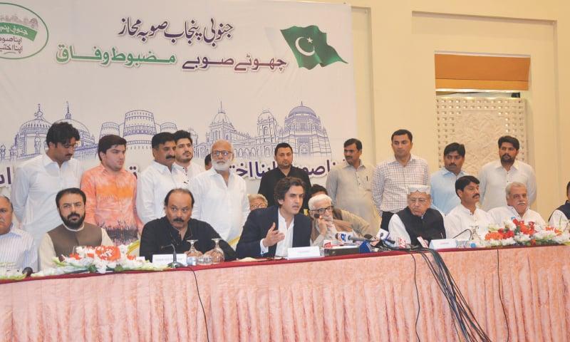 LAHORE: PML-N MNA Khusro Bakhtiar announces resignation along with MNAs Tahir Bashir Cheema, Tahir Iqbal Chaudhry, Basit Bokhari and Rana Qasim Noon and MPA Nasrullah Dreshak at a press conference on Monday. Former prime minister Mir Balakh Sher Mazari is also seen.—Dawn