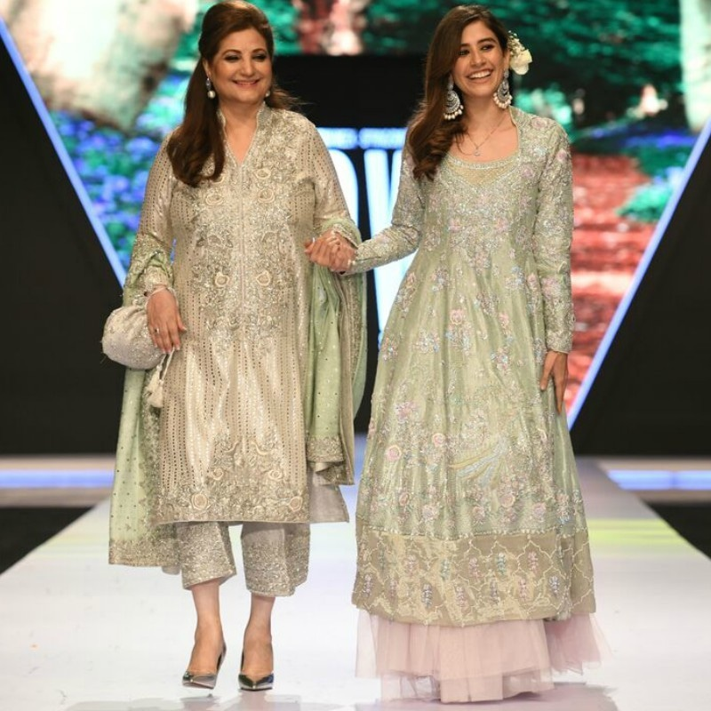 Syra Shahroz (R) walked the runway with her mother-in-law