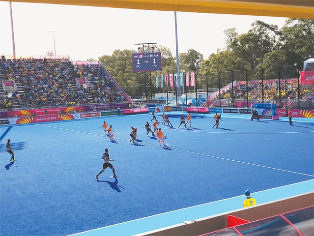 GOLD COAST: Pakistan hockey players thwart Malaysia's scoring attempt in a crucial stage of their match at the Commonwealth Games on Wednesday.