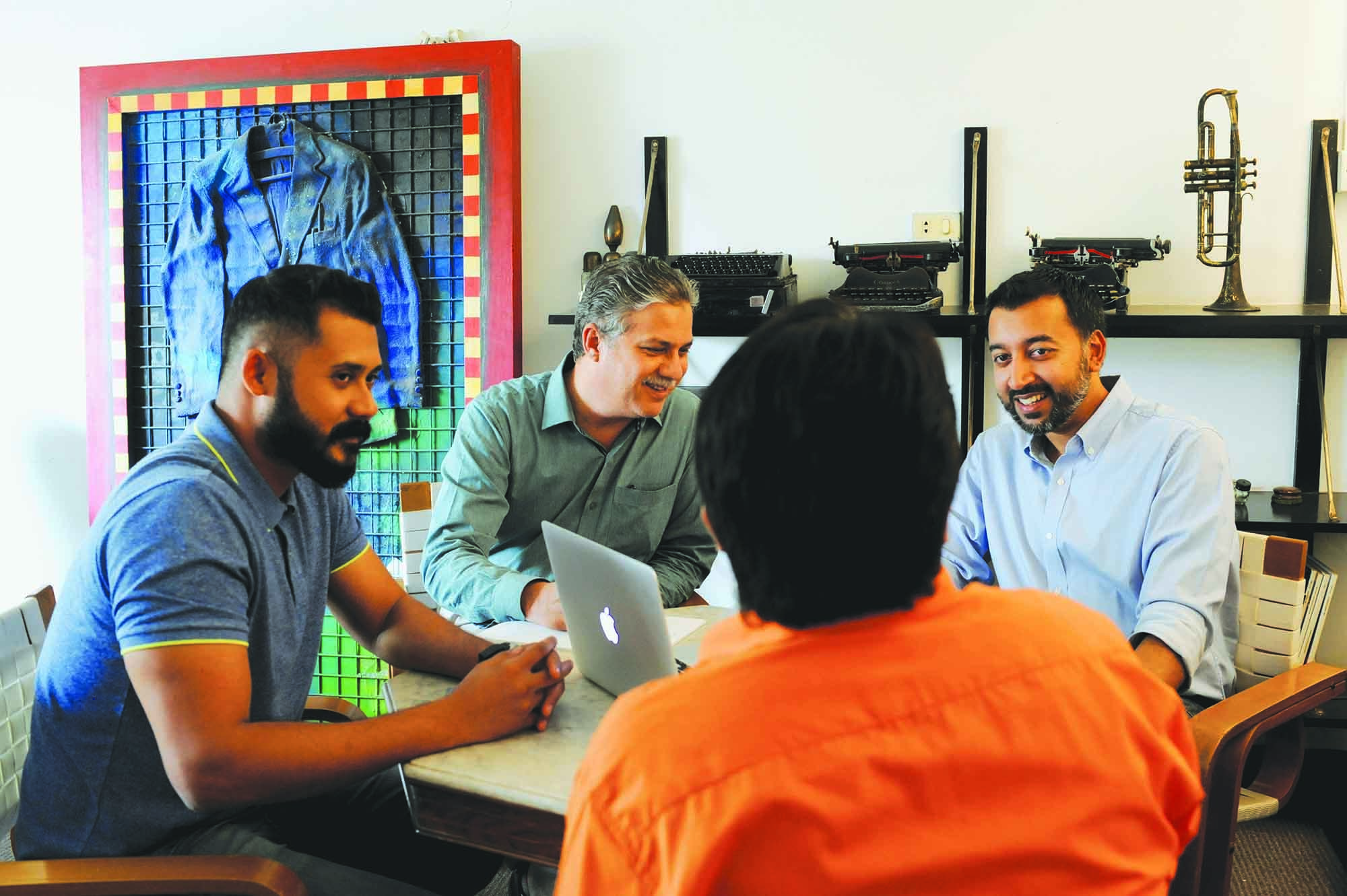 Gibran Mir, CEO, Circuit DRAFTFCB, discussing a forthcoming campaign with his Art Director, Ghazi Salahuddin (seated next to him) and his Client Services Director (in orange). Circuit was established by Gibran Mir's father, the well known modern artist, Imran Mir in 1997. In this respect, Gibran Mir has big shoes to fill. Imran Mir was a trail blazing designer. Before he started Circuit, he set up the design unit for The Dawn Media Group, where he redesigned many of their publications, including the newspaper. At Circuit, Imran Mir is best remembered for his work on brands such as Good Milk, Habib Oil and of course MCB. His rebranding of MCB in the late nineties was followed by a change of signage for their 1,400 branches nationwide and is considered to be one of the most refreshing design upgrades the streets of Pakistan have seen since. In 1998, Circuit was affiliated with DRAFTFCB. (photo: Arif Mahmood/ Dawn White Star)
