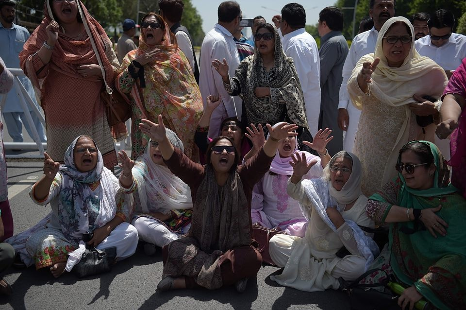 PML-N workers protesting outside the Supreme Court on April 13 against Nawaz's disqualification for life. — AFP