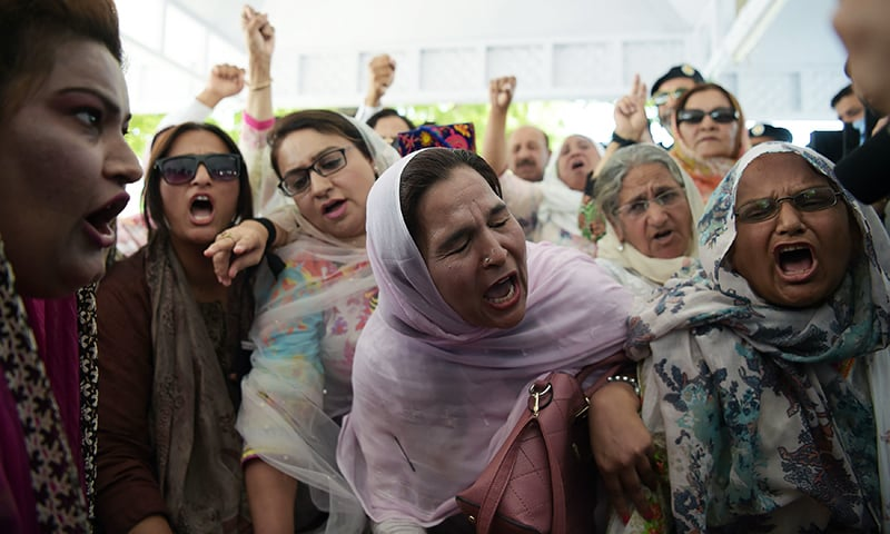 PML-N supporters shout slogans against the Supreme Court verdict to give a lifetime ban on their leader and former prime minister Nawaz Sharif in Islamabad on Friday. — AFP