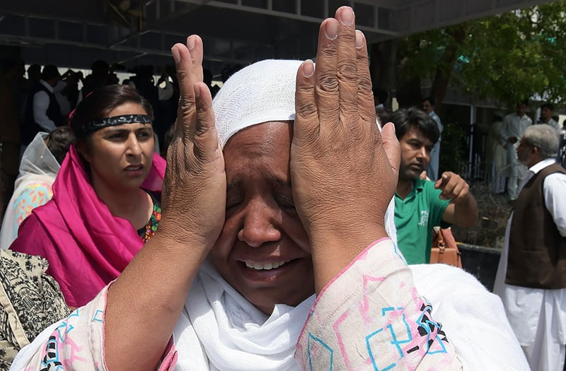 A PML-N supporter weeps after the Supreme Court verdict was announced. — AFP