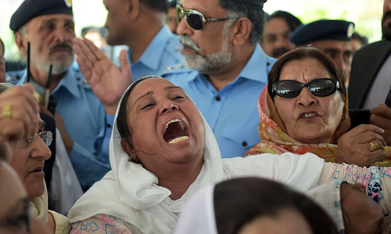 A PML-N supporter weeps after the Supreme Court verdict on Friday. — AFP