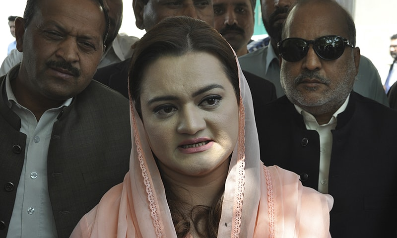 State Minister for Information Maryam Aurangzeb briefs reporters outside the Supreme Court in Islamabad following the verdict on disqualification. —  The Associated Press
