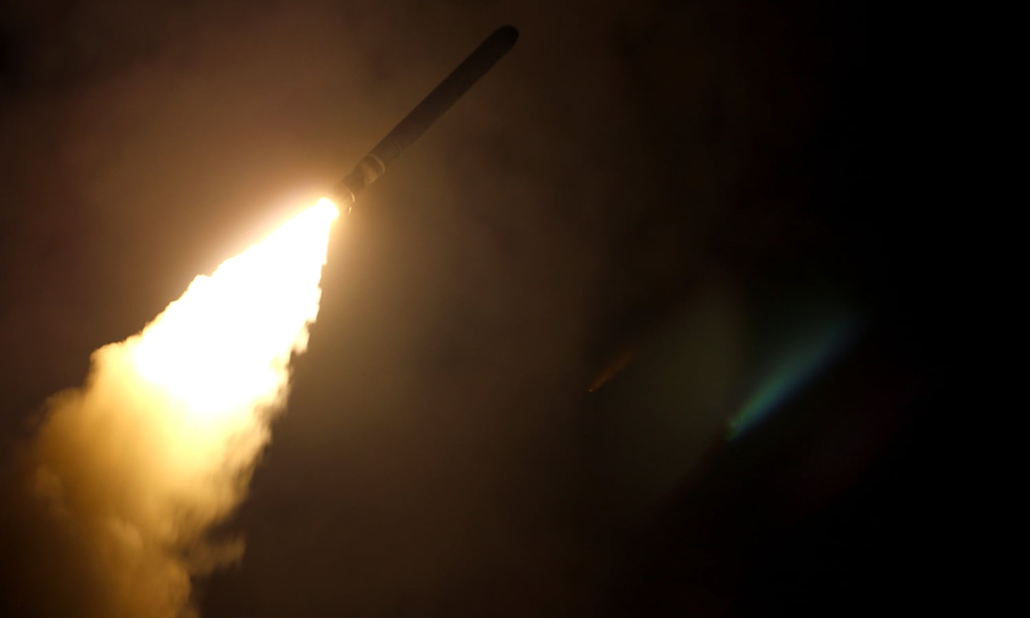 In this image released by the US Department of Defense the guided-missile cruiser USS Monterey fires a Tomahawk land attack missile on April 14, 2018. —AFP