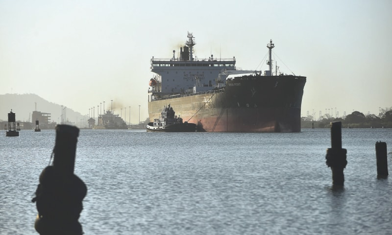 In this file photo ta cargo ship passes through the Panama Canals Pedro Miguel Locks on the outskirts of Panama City.Members of the UN International Maritime Organisation on April 13, struck a deal to halve carbon dioxide emissions from shipping by 2050 in a deal that will force the industry to redesign fleets.—AFP