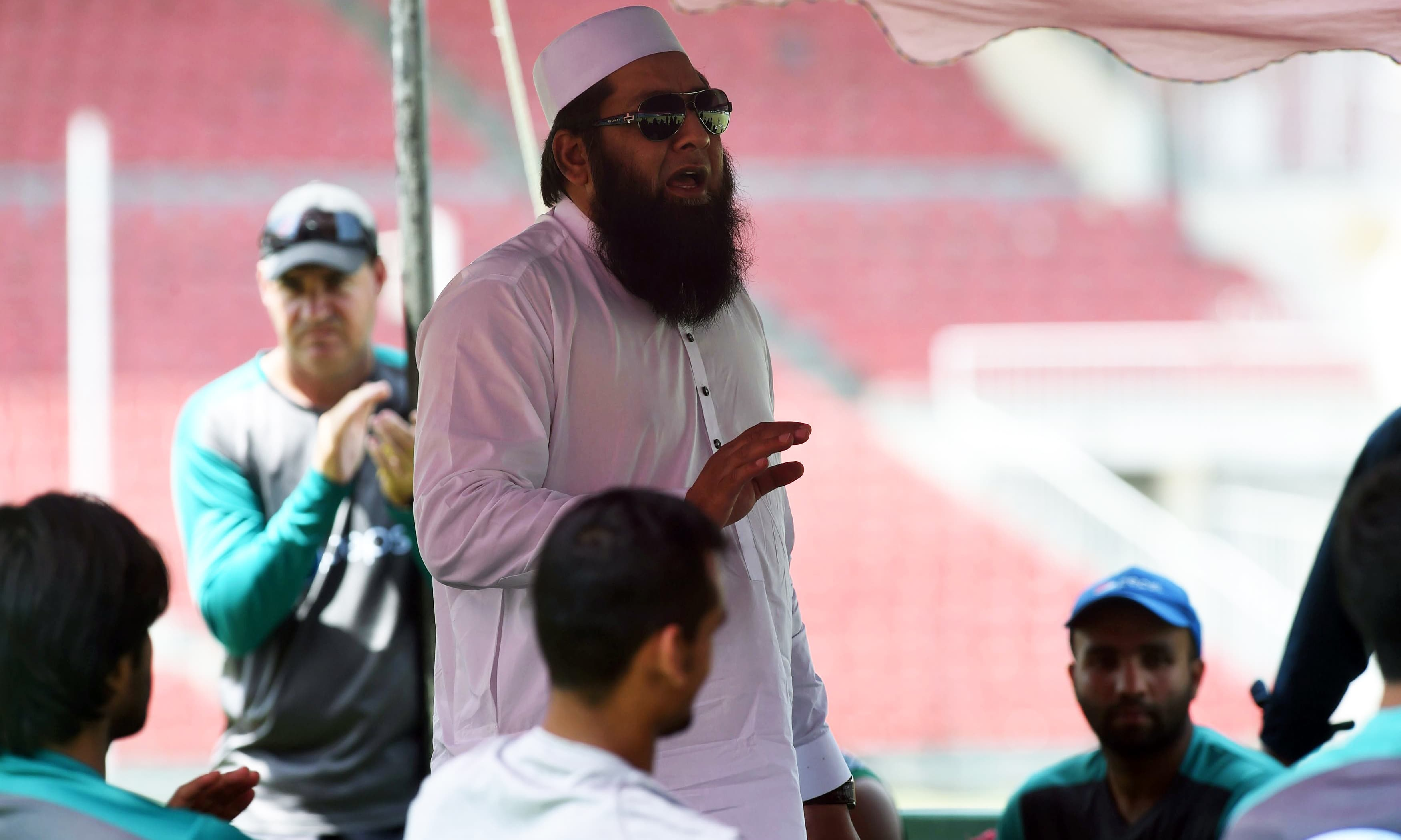 Chief selector Inzamam-ul-Haq speaks with the team during a team practice session in Lahore. —AFP