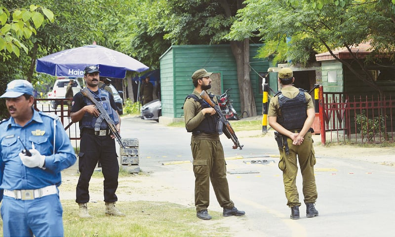 LAHORE: Rangers and police on high alert at the residence of Justice Ijaz-ul-Ahsan of the Supreme Court in Model Town on Sunday.—White Star