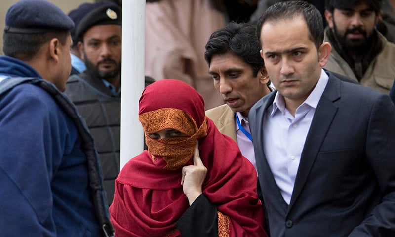 In this Jan 6, 2017 file photo, Maheen Zafar, the wife (C) of sessions judge Raja Khurram Ali Khan is escorted from the Supreme Court by her brother in Islamabad. — AP/File
