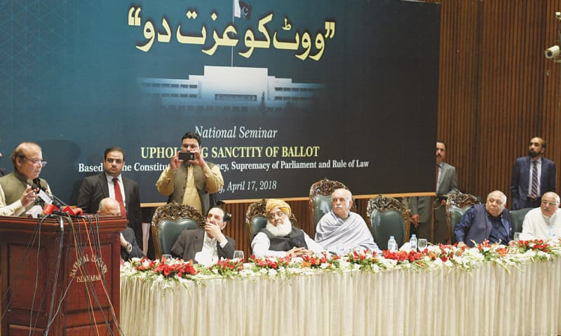 FORMER prime minister Nawaz Sharif addresses the seminar as Raja Zafarul Haq, Maulana Fazlur Rehman, Mehmood Khan Achakzai, Mir Hasil Bizenjo and Mian Iftikhar Hussain look on.—Tanveer Shahzad / White Star