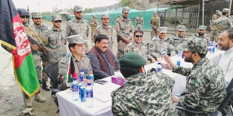 SECURITY officials of Afghanistan and Pakistan hold talks at the Torkham border on Wednesday.—Dawn