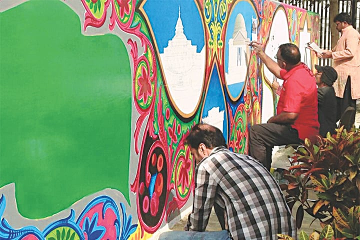 The 190-feet long wall at the visa section of the US Consulate, Karachi, getting a new look